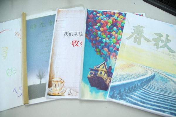 学生自己编辑成册的寒假班级作文集1.jpg图片